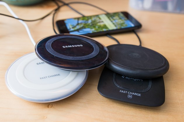 Four wireless chargers stacked on top of each other.